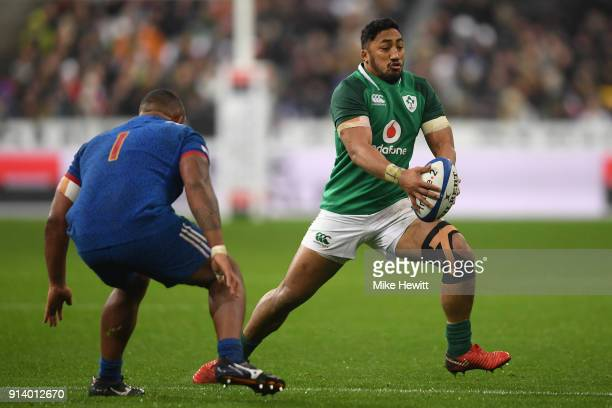 Bundee Aki of Ireland takes on Jefferson Poirot of France during the NatWest Six Nations match between France and Ireland at Stade de France on...