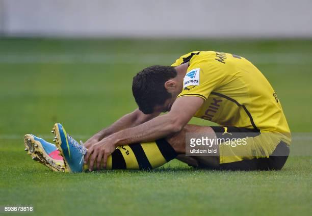 FUSSBALL 1 Bundesliga 2013/2014 Testspiel FC Luzern Borussia Dortmund Henrikh Mkhitaryan verletzt am Boden nach seinem Tor zum 13