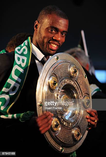 Bundesliga top scorer Grafite of Wolfsburg celebrates with the League trophy at the rathaus after winning the German championship after their...