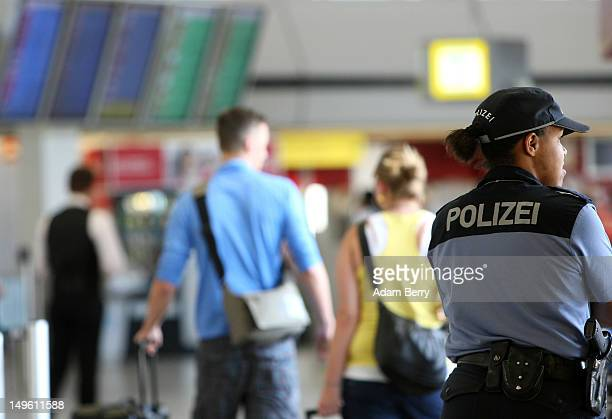Bundespolizei police officer stands at Tegel airport on August 1, 2012 in Berlin, Germany. The topic of today's German federal Cabinet meeting was...