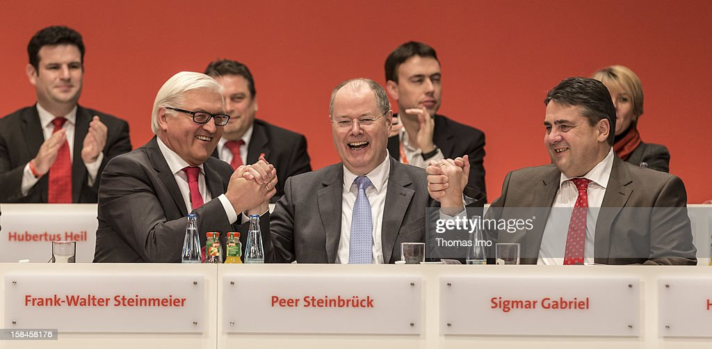 SPD Bundestag faction leader Frank-Walter Steinmeier, Peer Steinbrueck, chancellor candidate of the German Social Democrats (SPD) and German Social Democrats (SPD) Chairman Sigmar Gabriel, applaud at the SPD federal party convention on December 9, 2012 in Hanover, Germany. The SPD is convening to set its policy course for the next year and to celebrate Steinbrueck, who will run for chancellor in elections set for 2013.