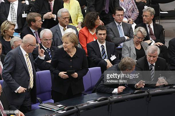 CDU Bundestag faction leader Volker Kauder German Chancellor and head of the German Christian Democrats Angela Merkel presidential candidate...