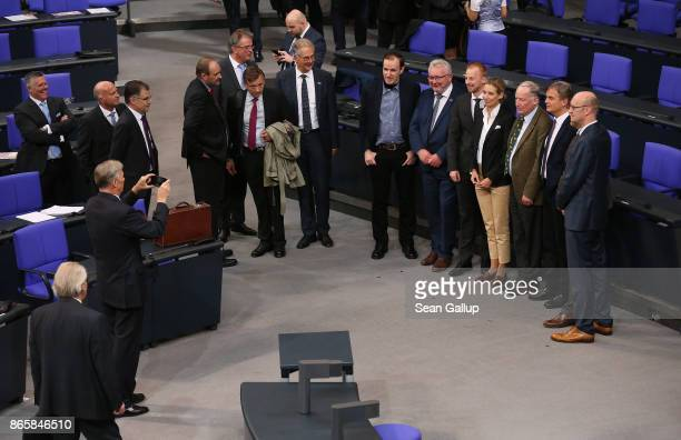 Bundestag faction members of the rightwing Alternative for Germany snap a group photo at the conclusion of the opening session of the new Bundestag...