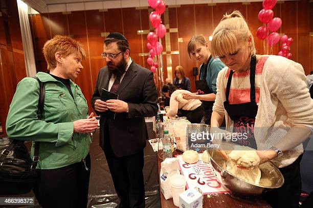 Bundestag Vice President Petra Pau and Rabbi Yehuda Teichtal attend the Mega Challah Bake at the local Chabad community's Kosher Festival on March 15...
