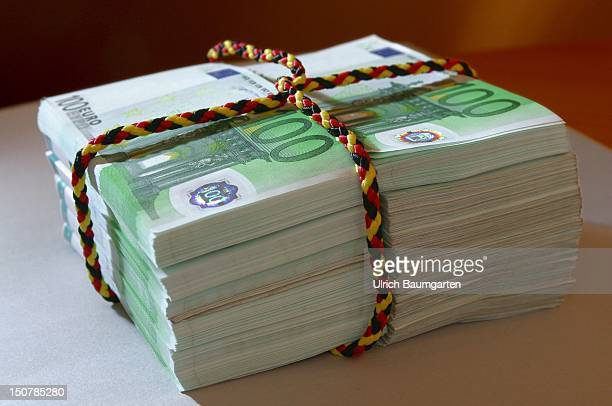 Bundle of 100 Euro notes tied up with a black red golden cord Symbolic pictur for the topic federal budget