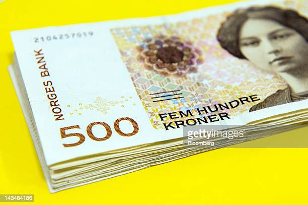A bundle of five hundred krone Norwegian bank notes are seen displayed for a photograph at a Forex currency exchange center in Oslo Norway on...