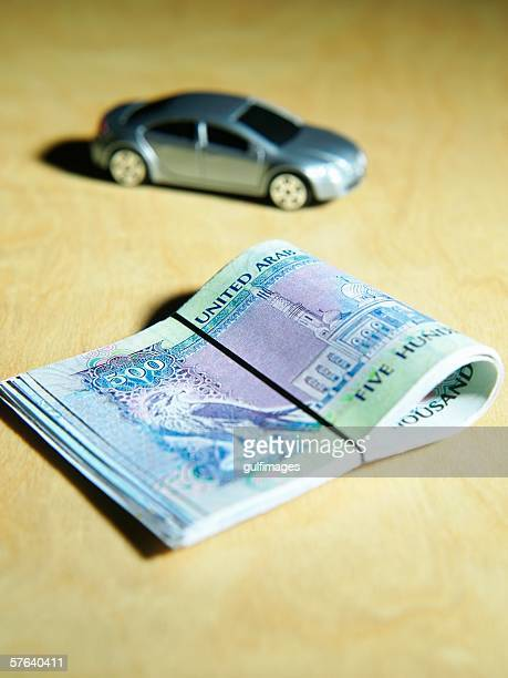 Bundle of Money and Car