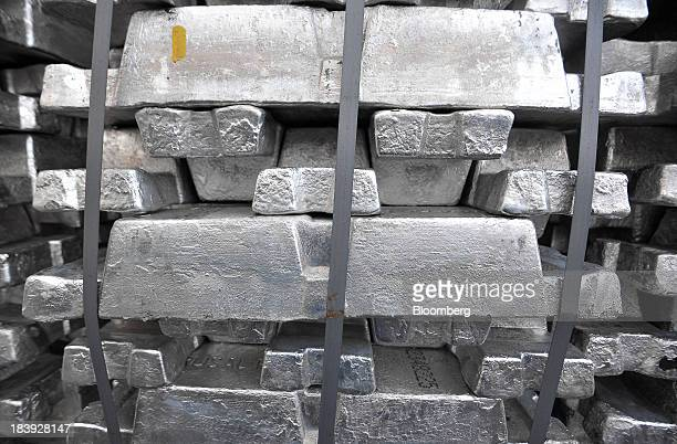 A bundle of newly moulded aluminum ingots sit in a storage yard before distribution at the Impol Seval AD plant in Sevojno Serbia on Wednesday Oct 9...