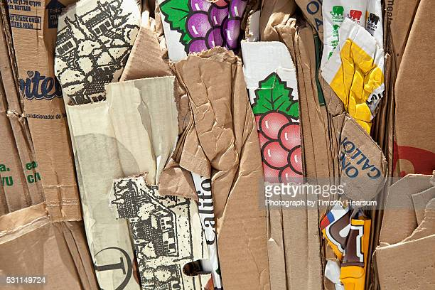 bundle of recycled cardboard - timothy hearsum stock pictures, royalty-free photos & images
