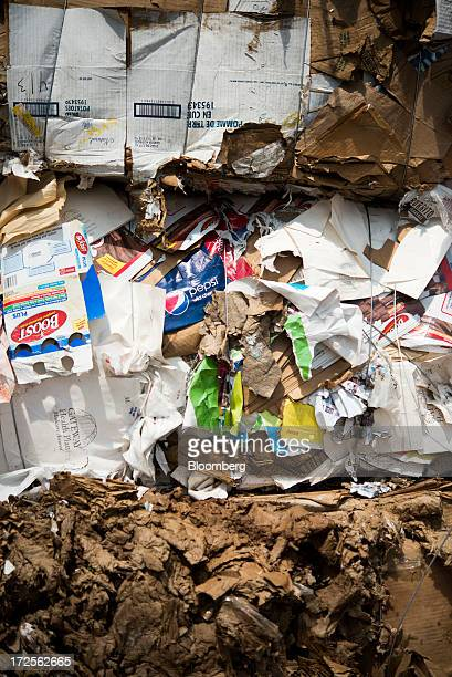 Bundled boxes of cardboard are stacked before being made into new cardboard product at Newark Recycled Paperboard Solutions in Baltimore Ohio US on...