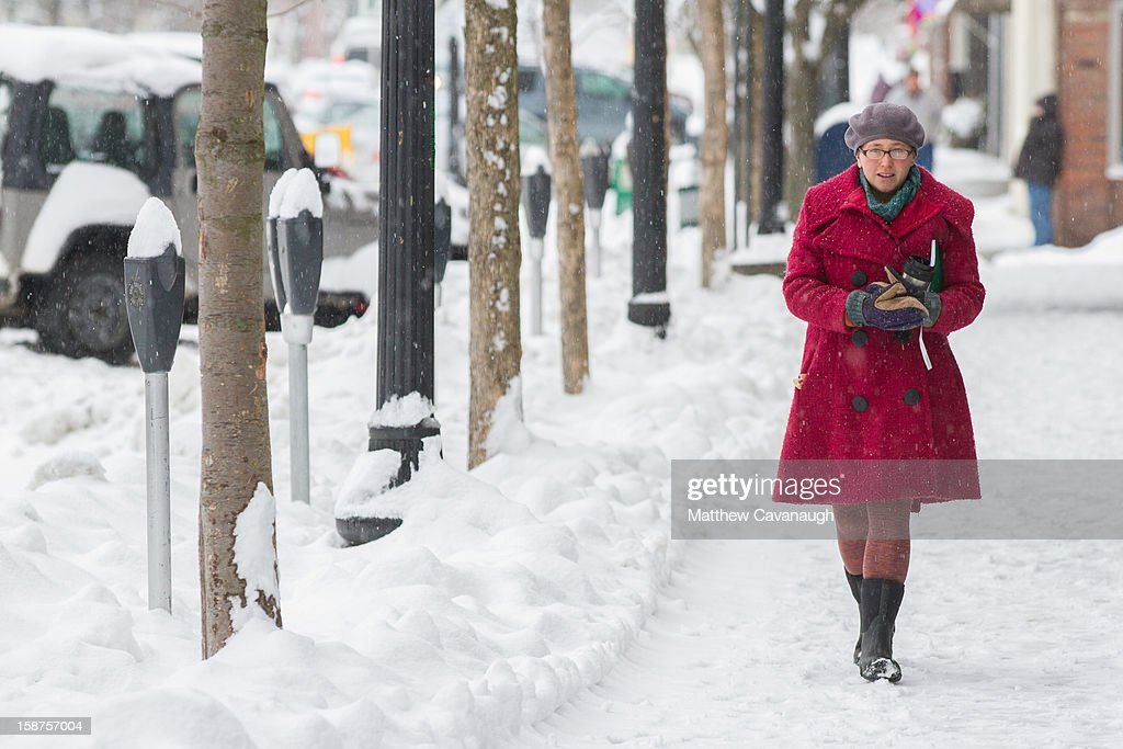 A bundled up pedestrian walks down Main St. on December 27, 2012 in Greenfield, Massachusetts. A serious winter storm that caused tornados in the South on Christmas Day swept across the Northeast on Thursday, bringing snow, sleet, rain and causing dangerous travel conditions.