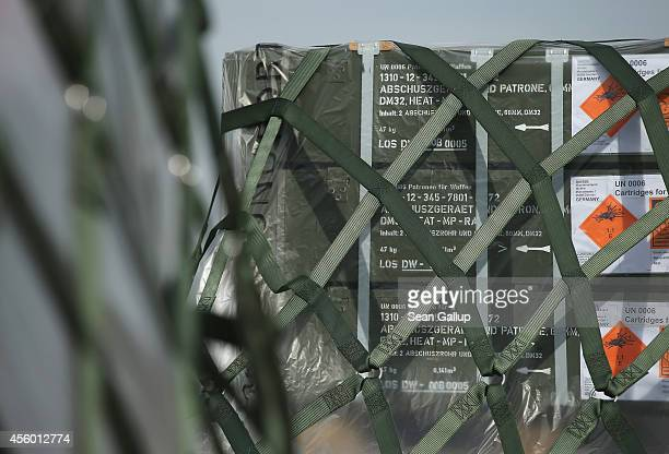 Bundled weapons and ammunition from the Bundeswehr, the German armed forces, destined for the Kurdish peshmerga in Iraq stand on the runway shortly...