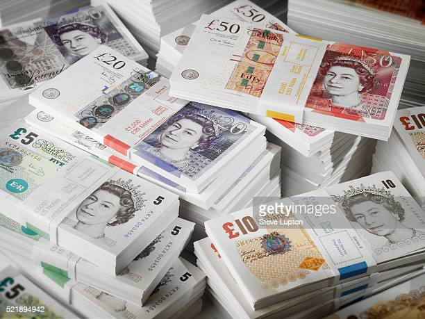 bundles and piles of uk banknotes - british pound sterling note stock pictures, royalty-free photos & images