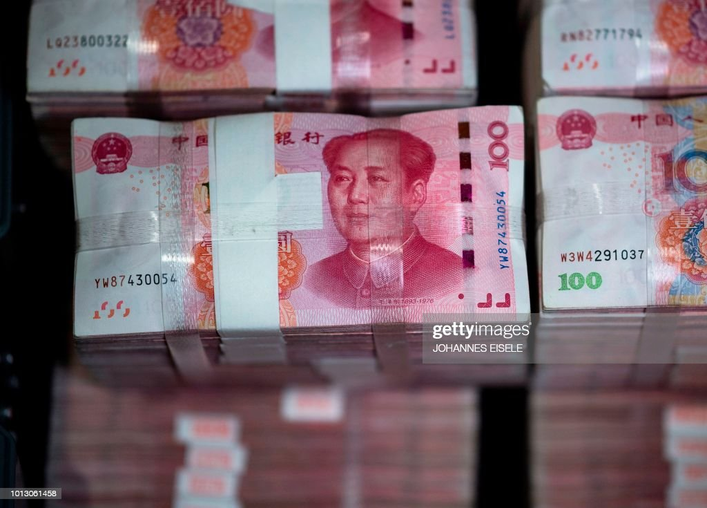 Bundles Of 100 Yuan 14 6 Usd Notes Are Pictured At A Bank In Shanghai