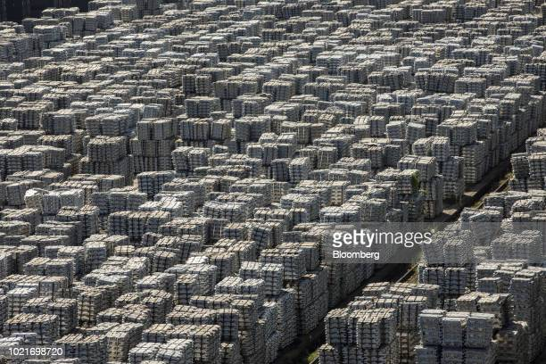 Bundles of aluminum ingots sit stacked at a China National Materials Storage and Transportation Corp stockyard in Wuxi China on Thursday Aug 23 2018...