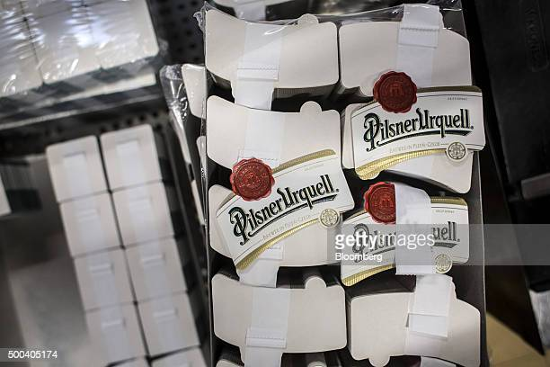 Bundles of beer bottle labels sit before attachment at the Pilsner Urquell brewery operated by SABMiller Plc in Plzen Czech Republic on Monday Dec 7...