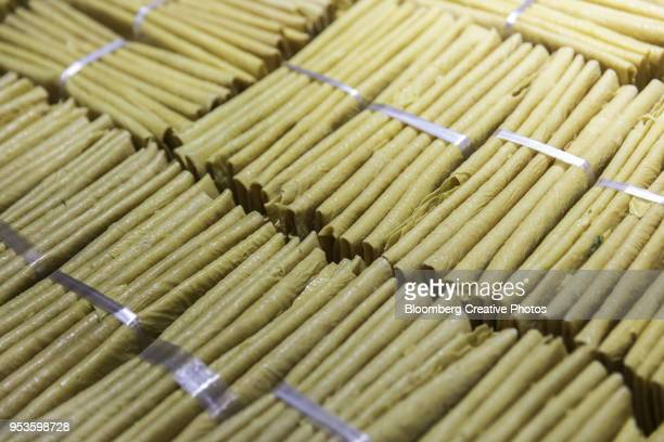 Bundles of dried tofu skin are displayed for sale