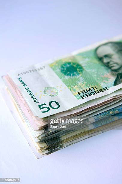 Bundles of mixed denomination krone currency notes sit in this arranged photograph in Oslo Norway on Friday July 13 2013 Norway's underlying...