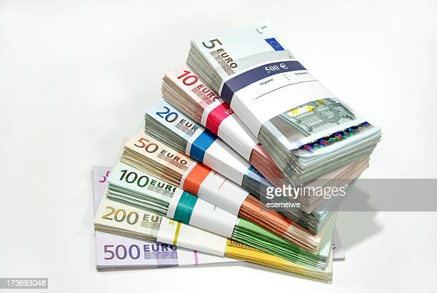 bundles of money - euro symbol stock photos and pictures