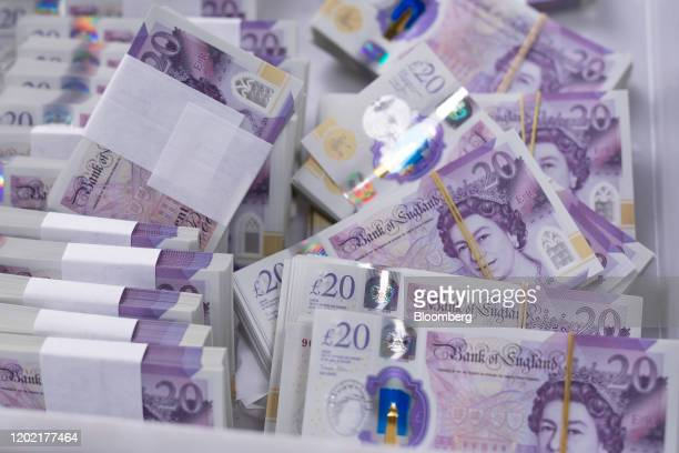 Bundles of new polymer British 20pound banknotes sit in a basket in a warehouse operated by G4S Plc in London UK on Thursday Feb 20 2020 Political...
