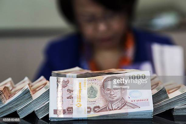 Bundles of onethousand baht banknotes are arranged for a photograph inside a Bangkok Bank Pcl branch at the company's headquarters in Bangkok...