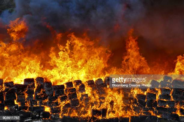 bundles of seized marijuana are incinerated at a military base - base_(politics) stock pictures, royalty-free photos & images