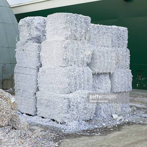 Bundles of shredded paper at recycling center