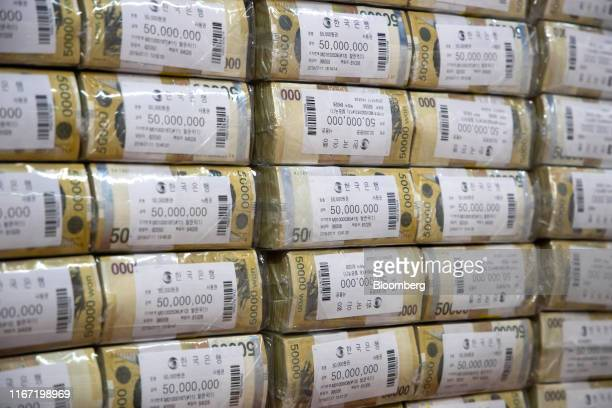 Bundles of South Korean 50000 won banknotes sit stacked at the Bank of Korea Gangnam office building in Seoul South Korea on Tuesday Sept 10 2019 The...