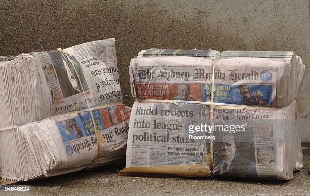 Bundles of wet Sydney Morning Herald newspapers published by Fairfax Media Ltd are discarded after a rainstorm in Sydney Australia on Monday Feb 12...
