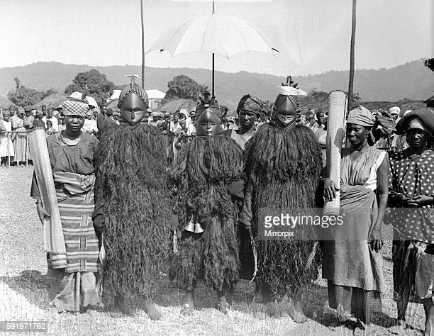 Bundu 'devil dancers' of Freetown in Sierra Leone dressed in wooden masks and carrying their mats on which they perform await the arrival of the...