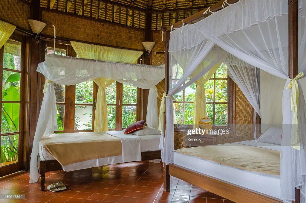 Bungalow and bed in a resort in Bali Indonesia : Stock Photo