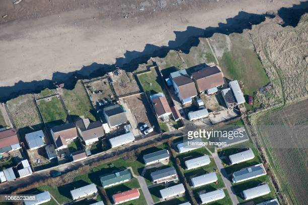 Bungalows at risk from further coastal erosion, Green Lane, near Skipsea, East Riding of Yorkshire, 2014. Artist Historic England Staff Photographer.