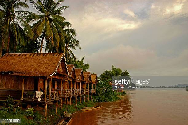 Bungalows on stilts by the Mekong