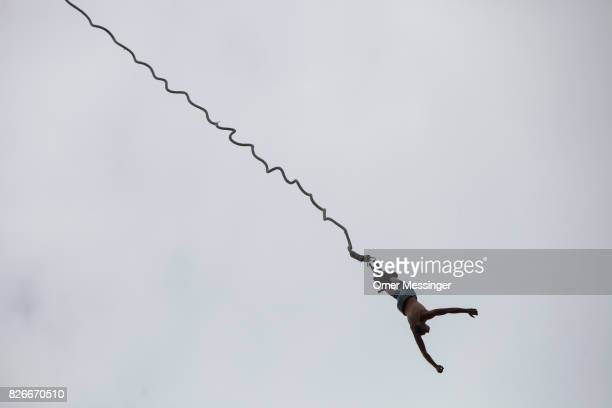 A bungee jumper at the 2017 Woodstock Festival Poland on August 4 2017 in Kostrzyn Poland The threeday rock music festival now in its 23rd year...