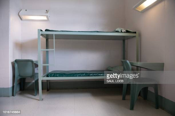 A bunk bed and desks inside a cell are seen at the Caroline Detention Facility in Bowling Green Virginia on August 13 2018 A former regional jail the...
