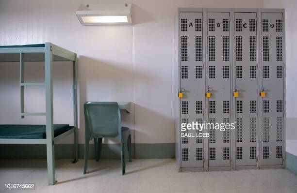 A bunk bed desk and lockers inside a cell are seen at the Caroline Detention Facility in Bowling Green Virginia on August 13 2018 A former regional...