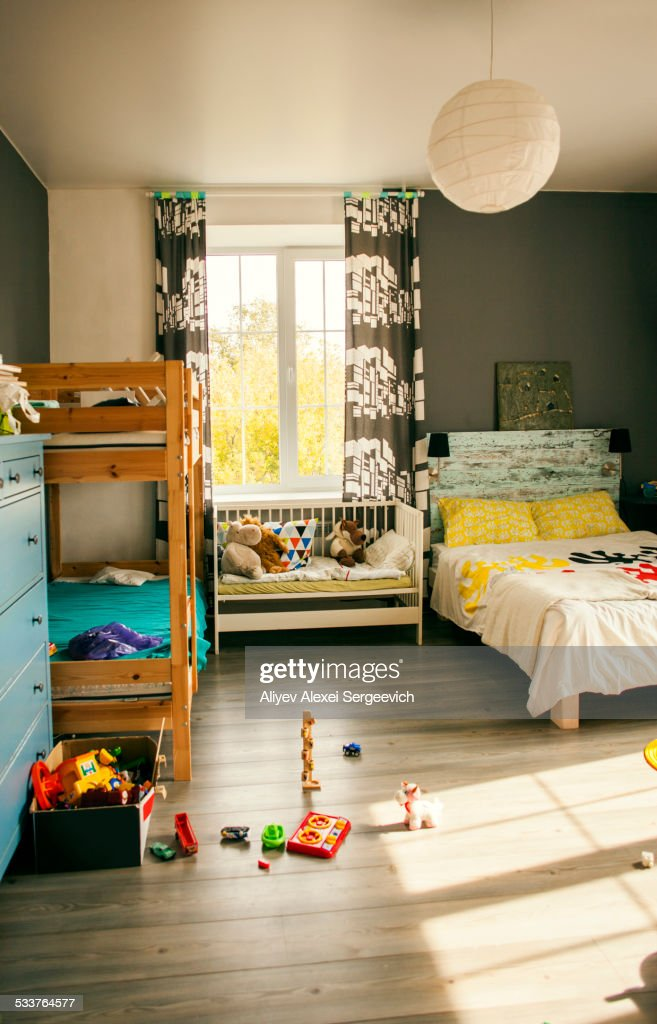 Bunk beds and crib in bedroom of child : Foto stock