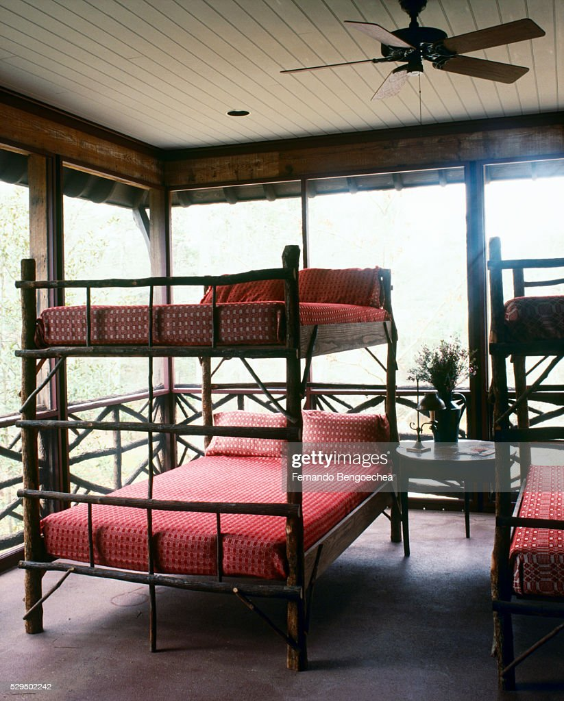Bunk Beds Made from Tree Branches on Screened Sleeping Porch : Stock Photo