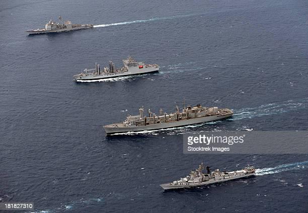 USS Bunker Hill, INS Shakti, USNS Bridge and INS Ranvir transit in formation.