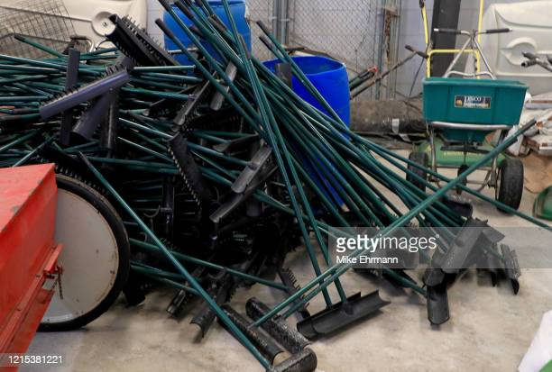 Bunker rakes sit in a maintenance shed to avoid outside contact as golf courses change their protocols in response to the coronavirus pandemic at...