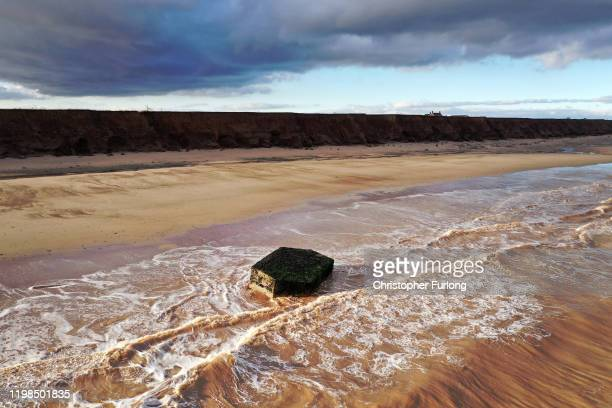 Bunker, which used to be situated on top of the cliffs observing the North Sea, now lays forlornly on the beach caused by coastal erosion of the...