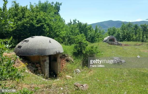 bunkers in the albanian landscape - koude oorlog stockfoto's en -beelden