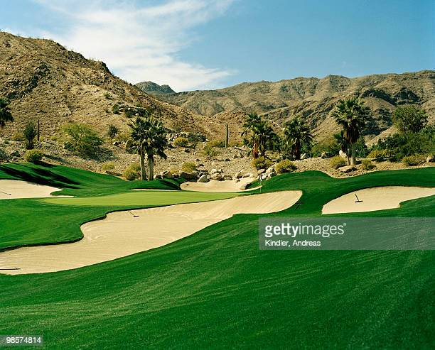 bunkers on a golf course, usa. - palm springs california stock pictures, royalty-free photos & images