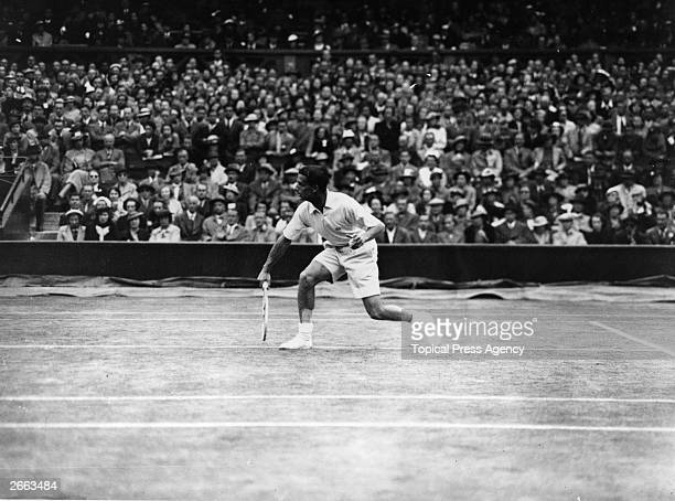 Bunny Austin of Great Britain in action during his men's singles semifinal match against Gottfried von Cramm of Germany at the Wimbledon Lawn Tennis...