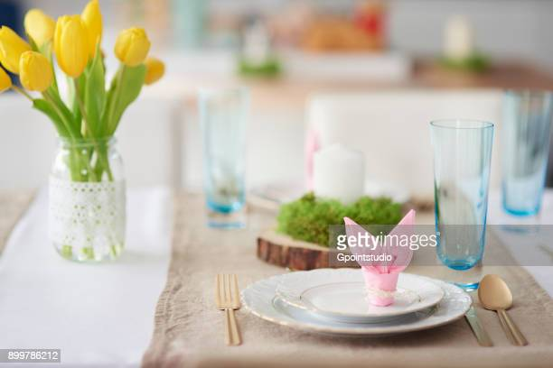Bunny ear napkin at easter table place setting