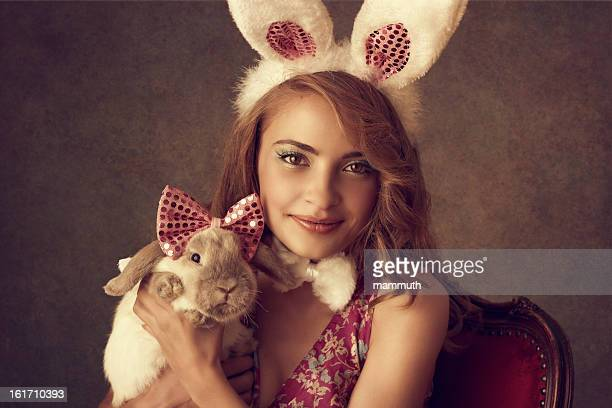 Playboy-bunny holding a rabbit