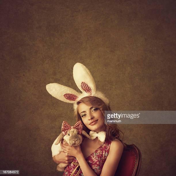 Playboy-bunny holding a rabbit