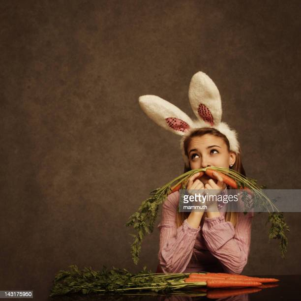 bunny girl with carrot mustache - playboy bunny images photos stock pictures, royalty-free photos & images
