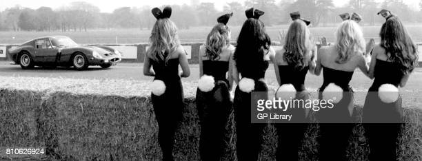 Bunny Girls watching Paul Vestey in a Ferrari 250GTO at the Goodwood Festival of Speed