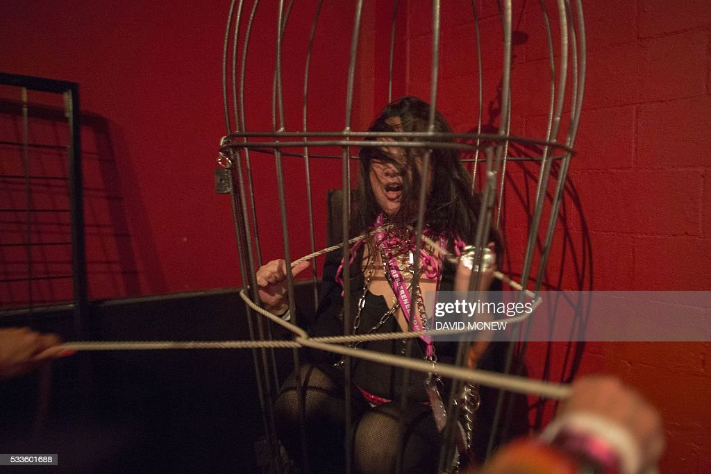 Bunny Lua Is tugged with a rope while caged at a dungeon